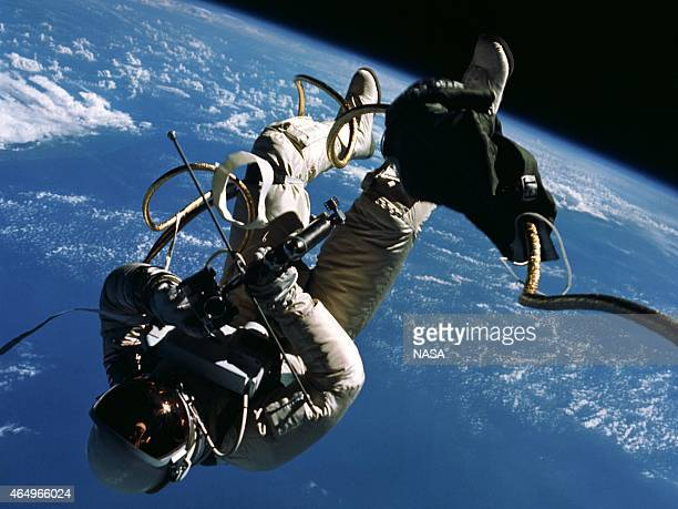 In this handout from National Aeronautics and Space Administration or NASA NASA Astronaut Ed White floats outside the Gemini 4 capsule June 3 1965 in...