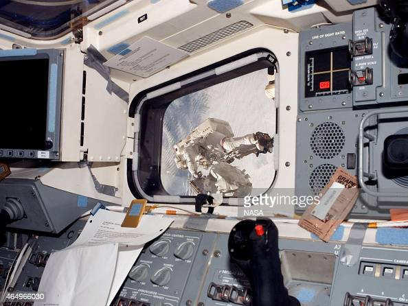 In this handout from National Aeronautics and Space Administration or NASA Visible through a window on space shuttle Endeavour's aft flight deck...