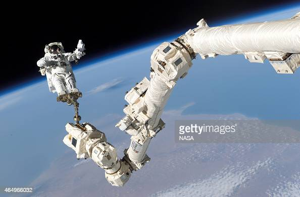In this handout from National Aeronautics and Space Administration or NASA Astronaut Stephen K Robinson STS114 mission specialist anchored to a foot...