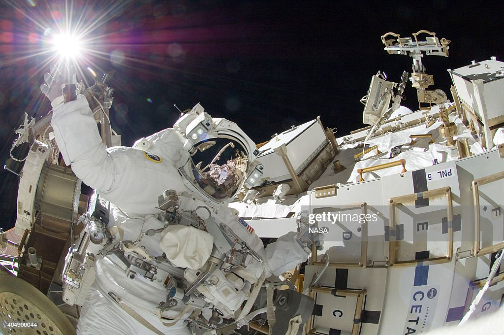 In this handout from National Aeronautics and Space Administration or NASA, NASA astronaut <a gi-track='captionPersonalityLinkClicked' href=/galleries/search?phrase=Sunita+Williams&family=editorial&specificpeople=4001582 ng-click='$event.stopPropagation()'>Sunita Williams</a>, Expedition 32 flight engineer, raises her hand during the mission's third session of extravehicular activity (EVA) September 5, 2012 in space.