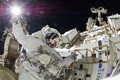 In this handout from National Aeronautics and Space Administration or NASA NASA astronaut Sunita Williams Expedition 32 flight engineer raises her...