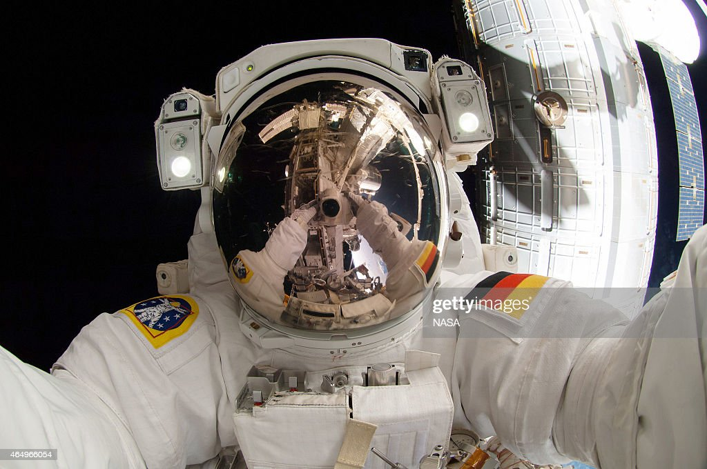 In this handout from National Aeronautics and Space Administration or NASA, European Space Agency (EPA) astronaut <a gi-track='captionPersonalityLinkClicked' href=/galleries/search?phrase=Alexander+Gerst&family=editorial&specificpeople=5862799 ng-click='$event.stopPropagation()'>Alexander Gerst</a>, Expedition 41 flight engineer, uses a camera to make a photo of his helmet visor during a session of extravehicular activity (EVA) outside the International Space Station (ISS) October 7, 2017 in space. During the six-hour, 13-minute spacewalk, Gerst and NASA astronaut Reid Wiseman, flight engineer, worked outside the Quest airlock to relocate a failed cooling pump to external stowage and installed gear that provides back up power to external robotics equipment.