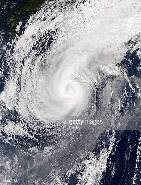 In this handout from National Aeronautics and Space Administration Typhoon Nuri moves northeasterly on November 5 passing the island of Iwo To Japan...