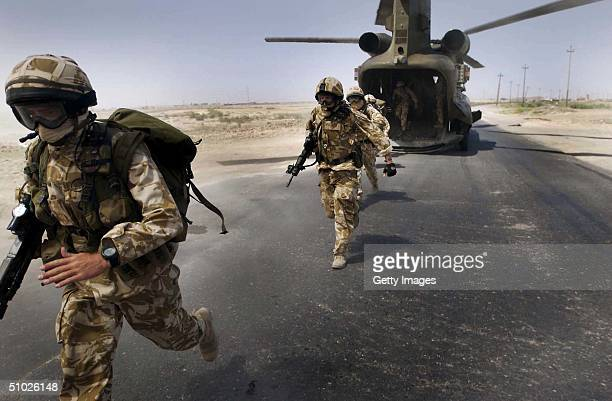 In this handout from the British Army soldiers from the The Royal Welch Fusiliers mount helicopter borne Eagle VCP's July 2 2004 around the southern...