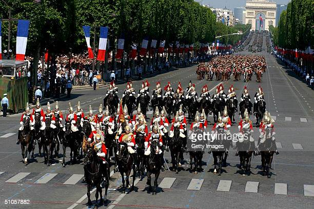 In this handout from the British Army the Household Cavalry Mounted Regiment ride down the Champs Elysees at the start of the annual Bastille Day...