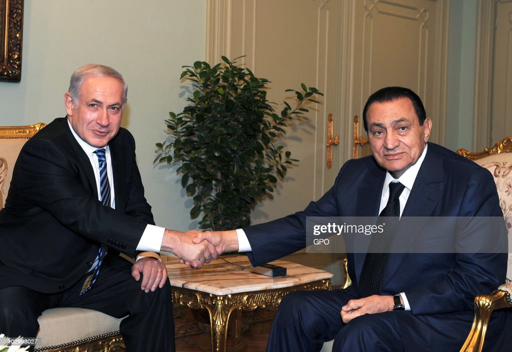 In this handout from the Israeli Govermental Press Office (GPO), Prime Minister Benjamin Netanyahu (L) meets with Egyptian President Hosni Mubarak on July 18, 2010 in Cairo, Egypt. The two met to discuss the peace process between Israel and the Palestinians.