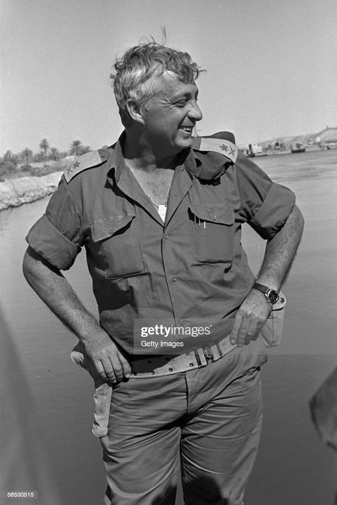 In this handout from the Israeli Governmental Press Office Southern Command General Ariel Sharon stands on the banks of the Suez Canal in the Sinai...