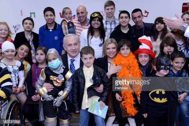 In this handout from the Israeli GPO Israeli Prime Minister Benjamin Netanyahu and his wife Mrs Sara Netanyahu hosts child cancer patients of the...