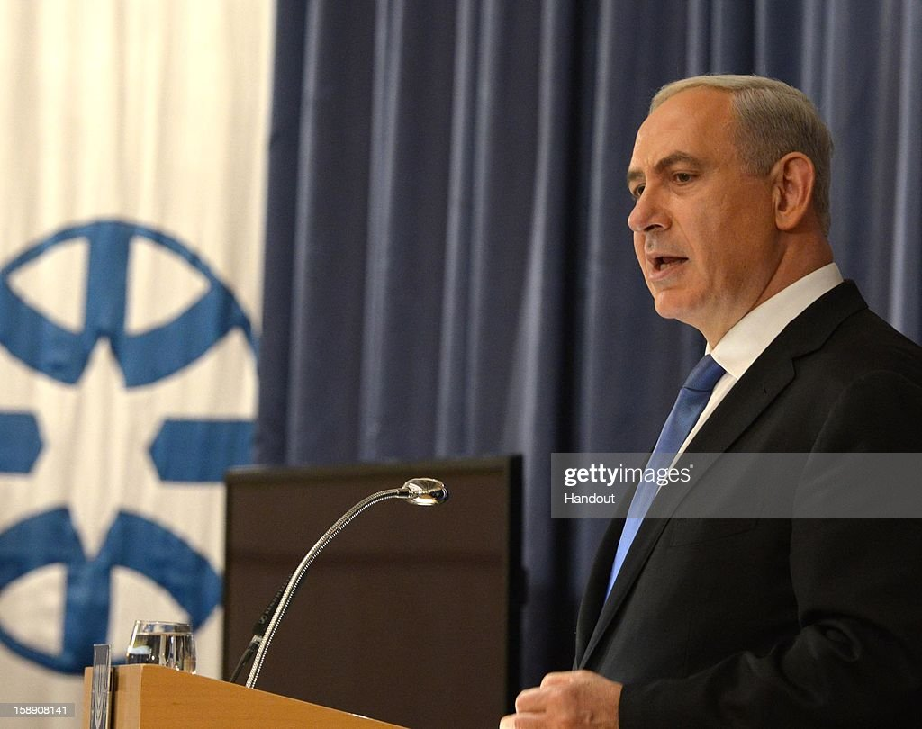 In this handout from the Israeli GPO, Israel's Prime Minister Benjamin Netanyahu addresses envoys at Ambassadors on January 3, 2013 in Jerusalem, Israel. Netanyahu's lead in the polls is decreasing as a pro-settler party makes gains.