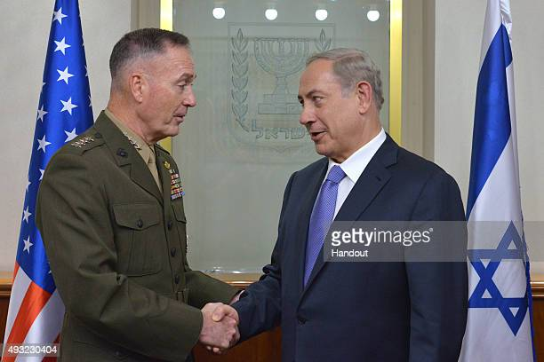 In this handout from the Israeli GPO Prime minister Benjamin Netanyahu shakes hands with Chairman of US Joint Chiefs of Staff Marine General Joseph...