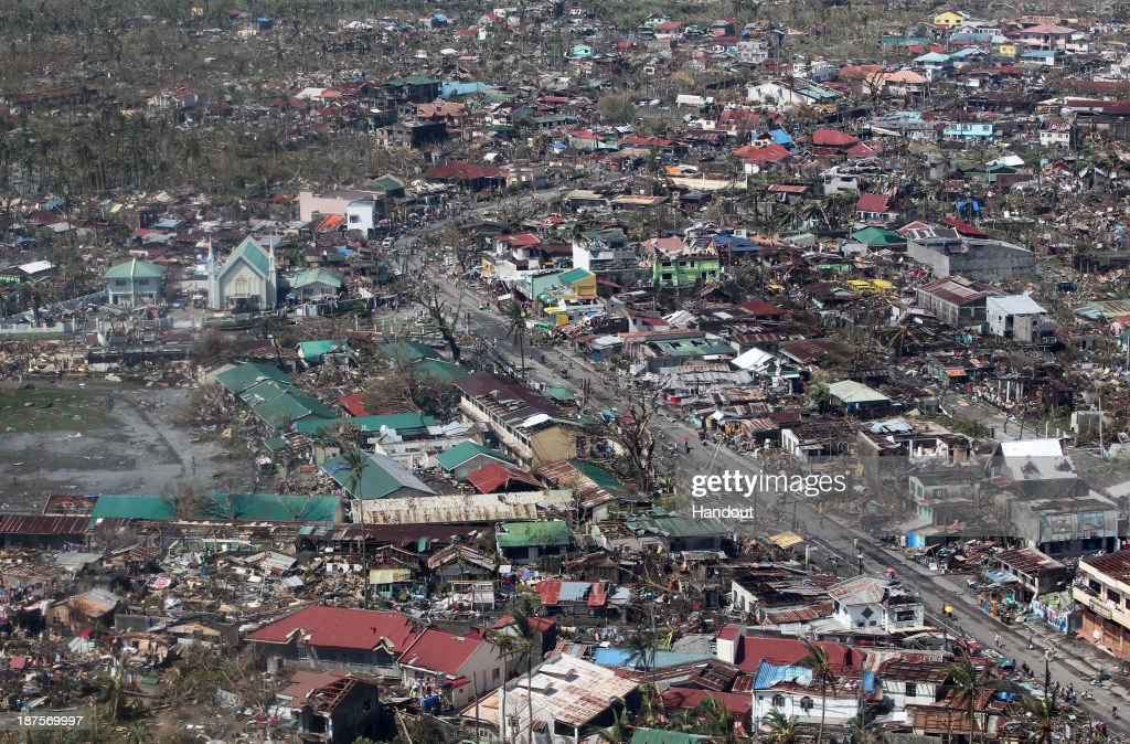 In this handout from the Malacanang Photo Bureau, an aerial view of buildings destroyed in the aftermath of Typhoon Haiyan on November 10, 2013 over the Leyte province, Philippines. Typhoon Haiyan, packing maximum sustained winds of 195 mph (315 kph), slammed into the southern Philippines and left a trail of destruction in multiple provinces, forcing hundreds of thousands to evacuate and making travel by air and land to hard-hit provinces difficult. Around 10,000 people are feared dead in the strongest typhoon to hit the Philippines this year.