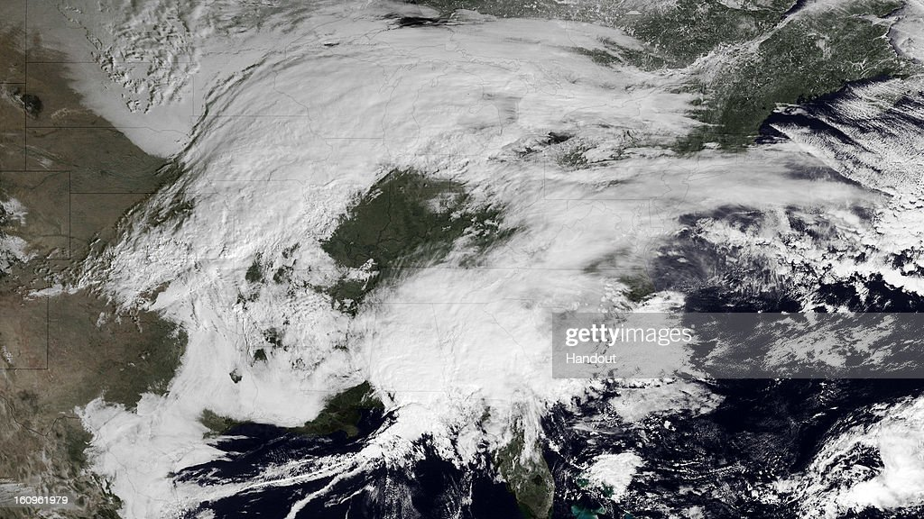 In this handout from the National Oceanic and Atmospheric Administration (NOAA), a storm moves up the eastern seaboard as another moves across the Central Plains February 8, 2013. Forecasters are predicting from two to four inches in Philadelphia to over two feet in Boston.