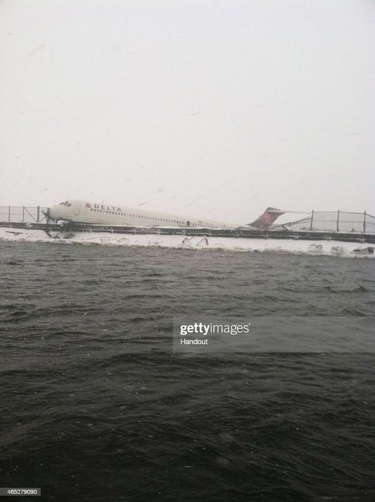 In this handout from the New York City Fire Department A Delta Air Lines jetliner rests on a berm at LaGuardia Airport March 5 2015 in Queens New...