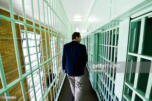 In this handout from the New York State Governor's Office New York Gov Andrew Cuomo walks past jail cells where two convicted murderers fled from the...