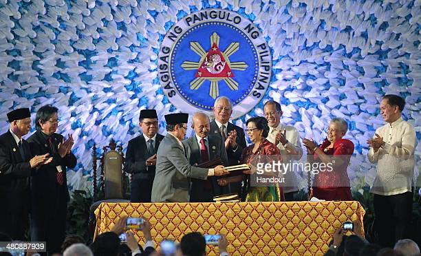 In this handout from the Presidential Photo Division President Benigno S Aquino III and Malaysian Prime Minister Dato' Sri Haji Mohammad Najib bin...