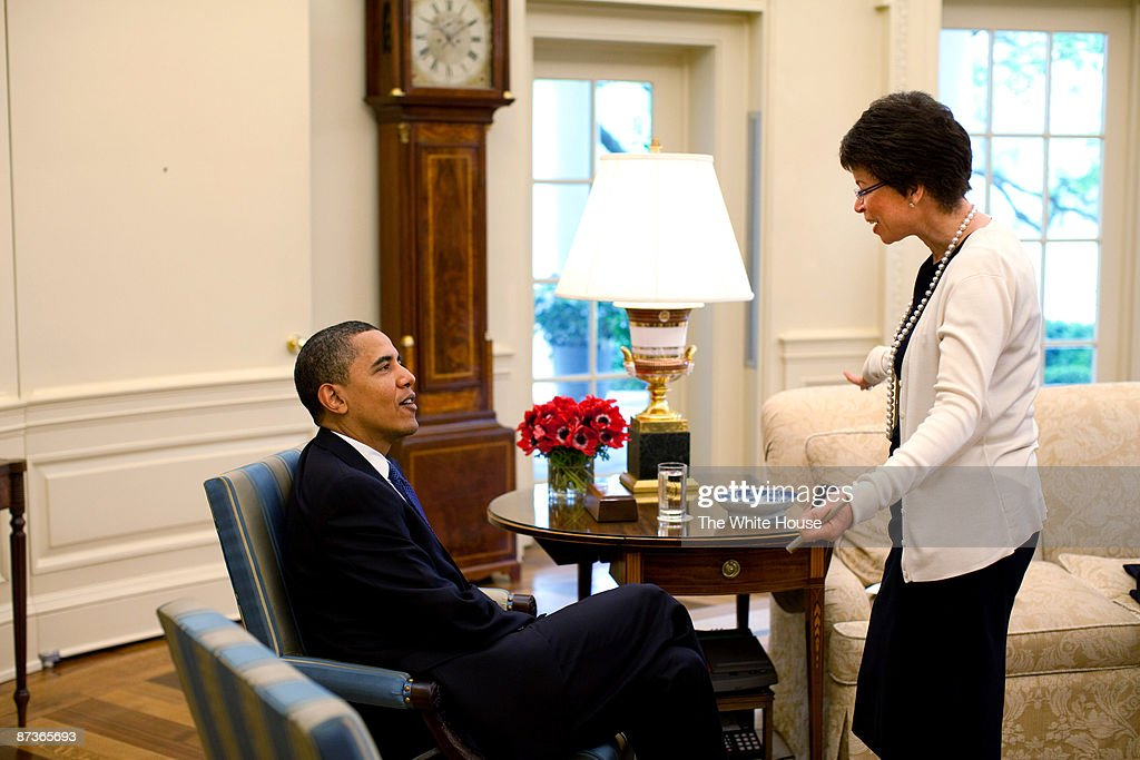 In this handout from the The White House US President Barack Obama talks with Senior Advisor Valerie Jarrett during a briefing in the Oval Office May...