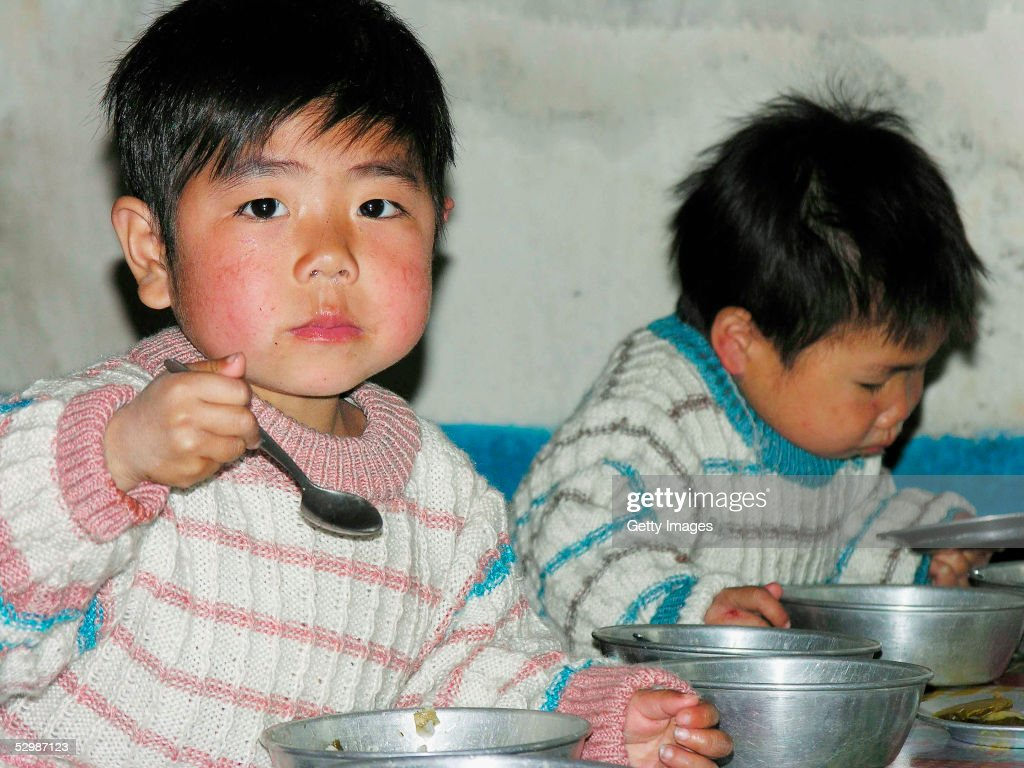 In this handout from the United Nations, North Korean boys eat lunch in a government-run nursery, on 20 April 2005 in Sariwon city, North Hwanghae province, North Korea. The United Nations World Food Programme's director for Asia, Tony Banbury, said in Seoul April 15, that a slump in donations for the agency's operation in North Korea would force it to halt aid distributions to almost all its 3.8 million 'core' beneficiaries over the next two months.