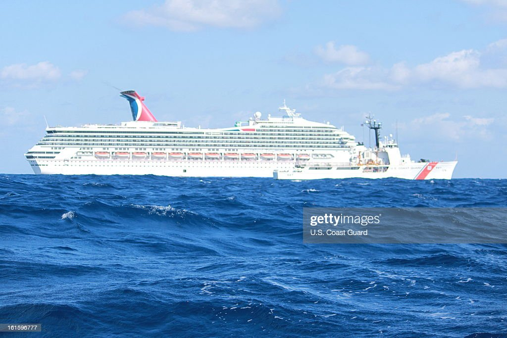 In this handout from the U.S. Coast Guard, the cruise ship Carnival Triumph sits idle February 11, 2013 in the Gulf of Mexico. According to the Coast Guard, the ship lost propulsion power February 10, after a fire broke out in the engine room.