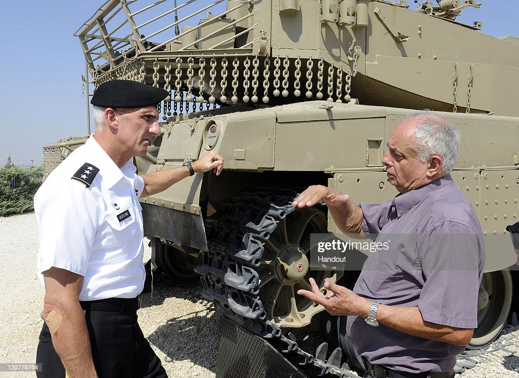In this handout from the U.S. Embassy, Director of the Zvi Meitar Institute for Land Warfare Studies Gideon Avidor (R) gives commanding general of the U.S. Army Europe Lt. Gen. Mark P. Hertling a tour of the Latrun Museum and grounds during a two-day tour of the country August 10, 2011 in Latrun, Israel. Lt. Gen. Hertling also met with his IDF counterpart, Maj. Gen. Sami Turgeman, to discuss training cooperation between the U.S. and Israeli militaries.