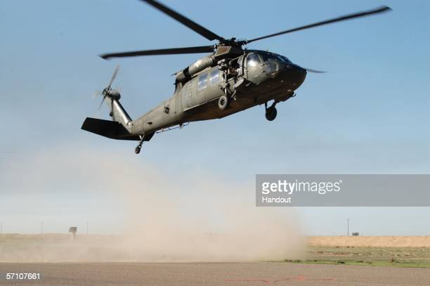 In this handout from the US Military A UH60 Blackhawk from the 101st Combat Aviation Brigade 101st Airborne Division takes off March 16 2006 from...