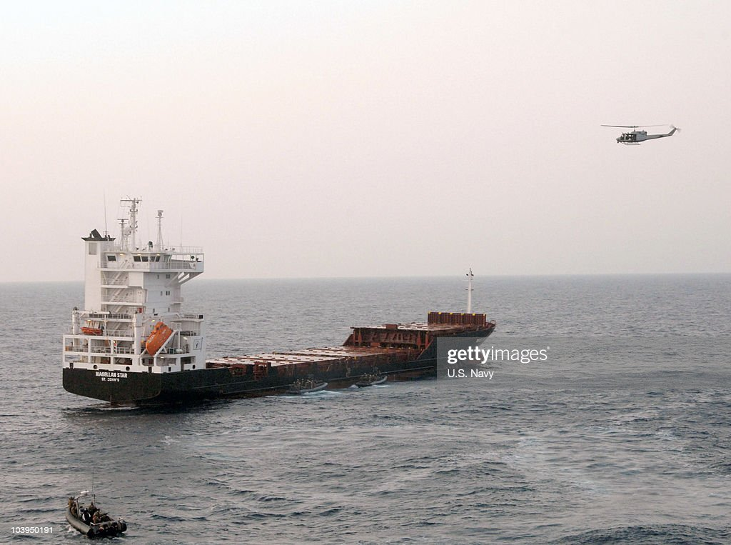 In this handout from the U.S. Navy, A Twin Huey helicopter provides cover as U.S. Marine Corps approach the Magellan Star during a boarding and seizure operation to retake the motor vehicle from suspected pirates September 9, 2010 in the Gulf of Aden. According to reports the U.S. Marines boarded the German owned ship after pirates had captured it on September 8, off the Somalia coast. It marks the first time that U.S. forces near Somalia have boarded a vessel taken by pirates.