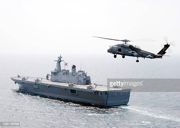 In this handout from the US Navy Sea Hawk helicopter assigned to the Chargers of Helicopter AntiSubmarine Squadron 14 flies near the Republic of...