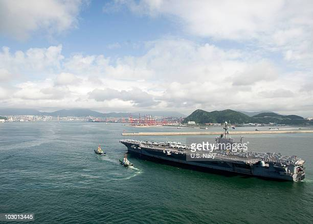 In this handout from the US Navy the aircraft carrier USS George Washington arrives on Wednesday July 21 2010 in Busan Republic of Korea This is the...