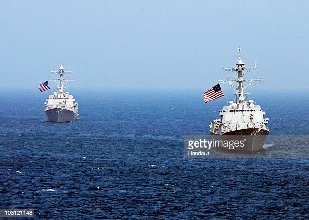 In this handout from the US Navy the guidedmissile destroyers USS Lassen and USS ChungHoon are underway in the Sea of Japan July 27 2010 in the East...