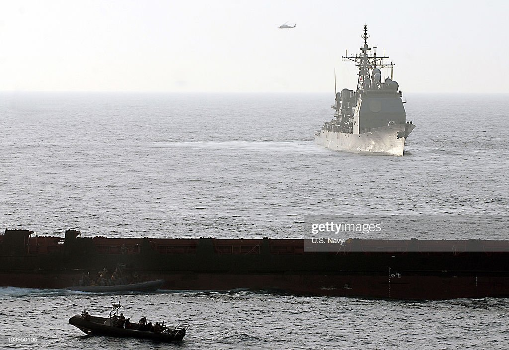 In this handout from the U.S. Navy, U.S. Marine Corps approach the Magellan Star during a boarding and seizure operation to retake the motor vehicle after it was attacked and boarded by pirates September 9, 2010 in the Gulf of Aden. According to reports the U.S. Marines boarded the German owned ship after pirates had captured it on September 8, off the Somalia coast. It marks the first time that U.S. forces near Somalia have boarded a vessel taken by pirates.