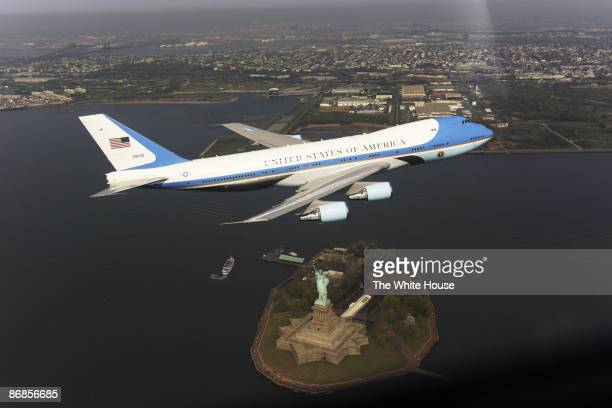 In this handout from the White House an Air Force presidential airplane flies over the Statue of Liberty April 27 2009 over New York Harbor White...