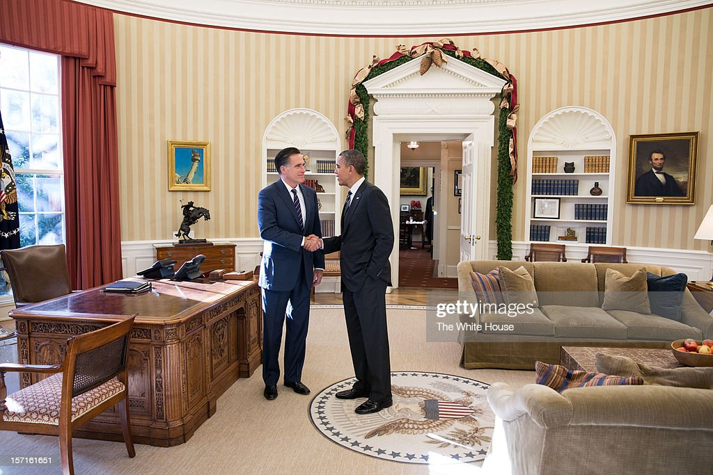 In this handout from the White House, Former Republican presidential candiate and Massachusetts Gov. Mitt Romney (L) shakes hands with U.S. President Barack Obama in the Oval Office following their lunch November 29, 2012 in Washington, DC . Obama had invited Romney to the White House for the lunch.