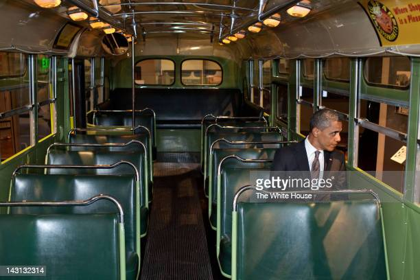 In this handout from The White House US President Barack Obama sits on the famed Rosa Parks bus at the Henry Ford Museum following an event April 18...