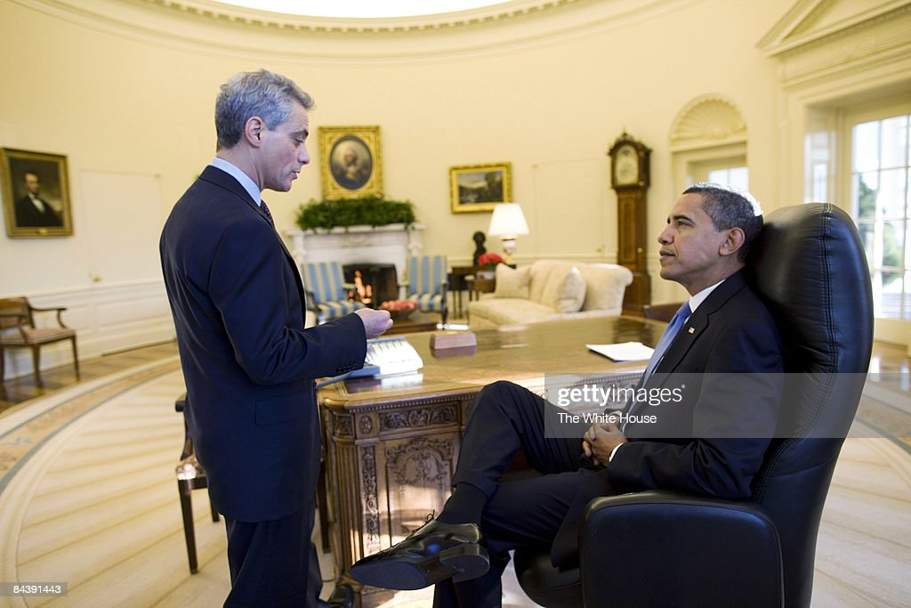 us president office. in this handout from the white house us president barack obama r talks us office o