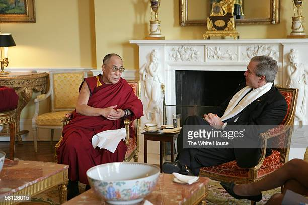 In this handout from The White House US President George W Bush wears a scarf that was presented to him by the Dalai Lama in the private residence of...