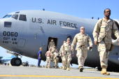 In this handout from US Coast Guard members of a US Coast Guard Port Security Unit team depart a US Air Force C17 Globemaster III aircraft after...
