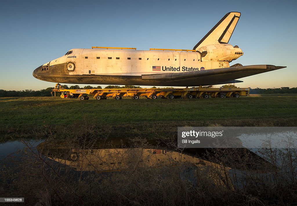 In this handout fromm NASA the space shuttle Atlantis rolls down Kennedy Parkway on its way to its new home at the Kennedy Space Center Visitor...
