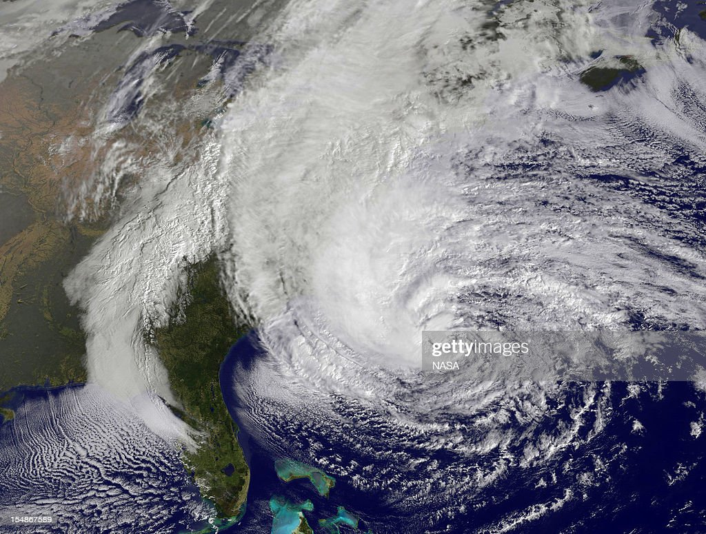 In this handout GOES satellite image provided by NASA, Hurricane Sandy, pictured at 1410 UTC, churns off the east coast on October 28, 2012 in the Atlantic Ocean. As states of emergency are declared, Sandy which has already claimed over 50 lives in the Caribbean is predicted to bring heavy winds and floodwaters to the mid-atlantic region.