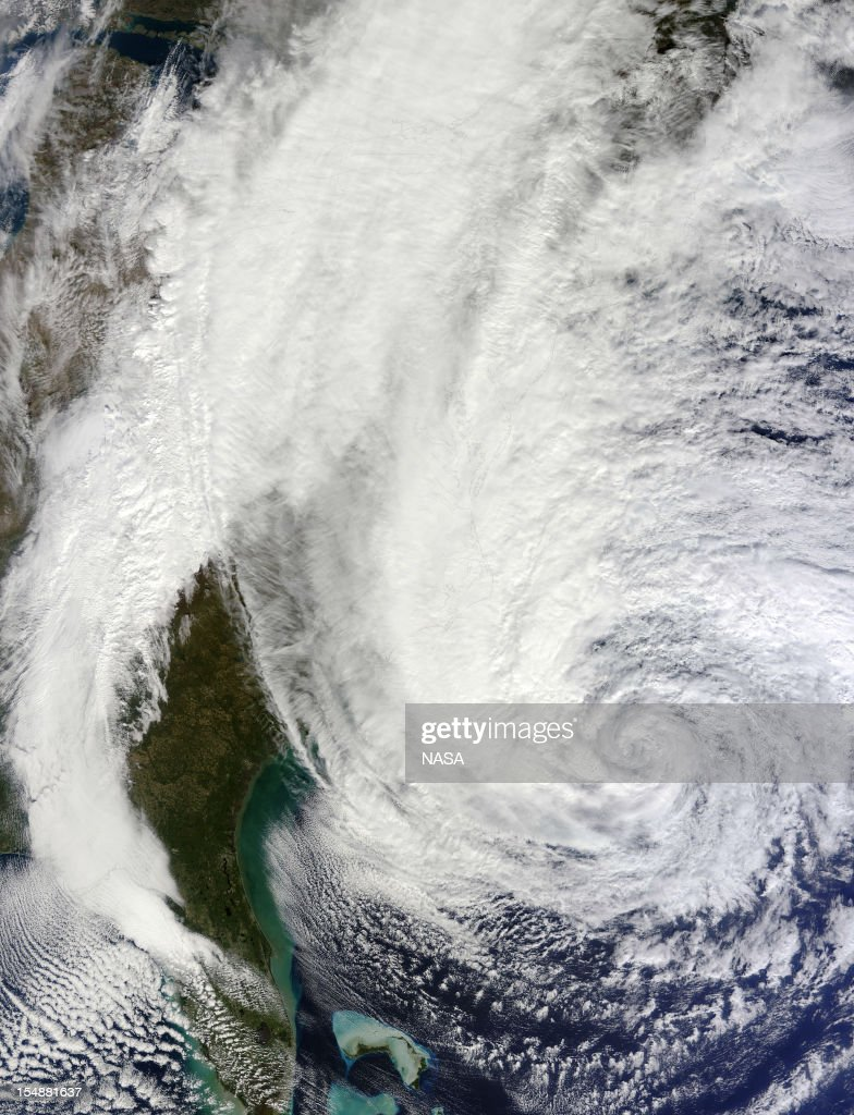 In this handout GOES satellite image provided by NASA, Hurricane Sandy, pictured at 16:00 UTC, churns off the East Coast as it moves north on October 28, 2012 in the Atlantic Ocean. Sandy, which has already claimed over 50 lives in the Caribbean is predicted to bring heavy winds and floodwaters to the mid-Atlantic region.