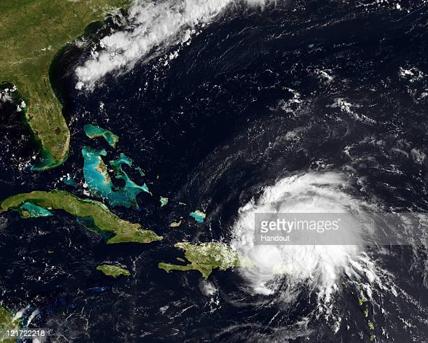 In this handout GOES satellite image provided by the National Oceanic and Atmospheric Administration Irene reaches hurricane strength as it moves...