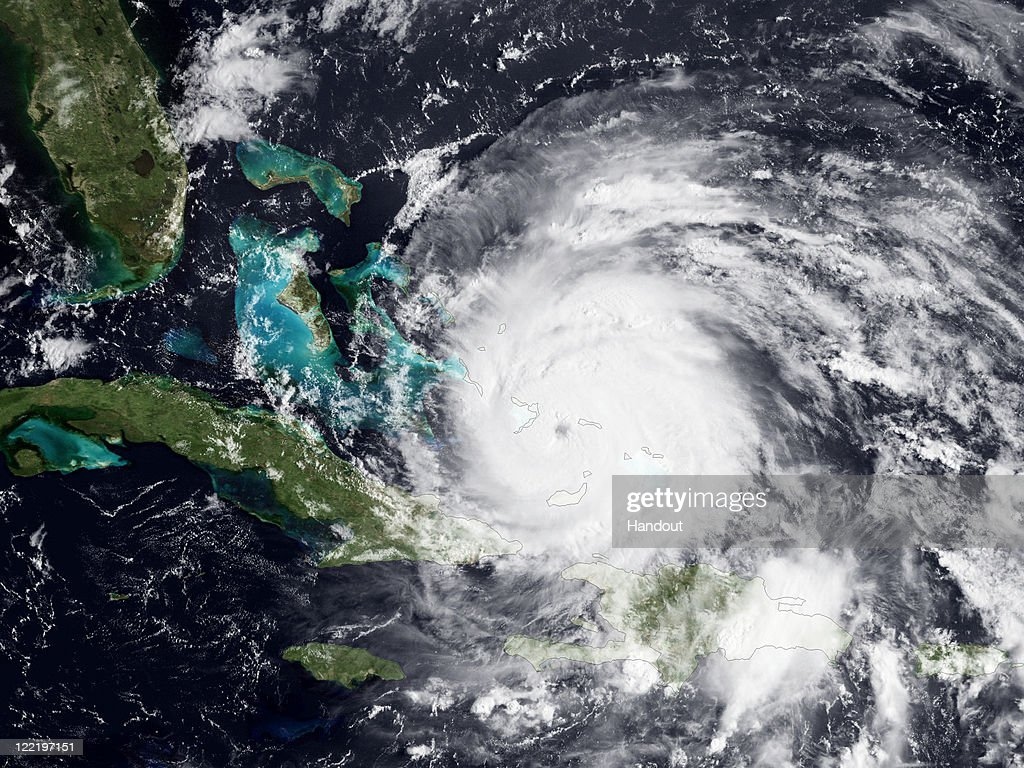 In this handout GOES satellite image provided by the National Oceanic and Atmospheric Administration (NOAA), colorized infrared and visible images show Hurricane Irene's eye forming on August 24, 2011 in the Caribbean Sea. After weakening slightly overnight, Irene's strength has come back with winds currently measured at 115 mph. The last hurricane hunter reconnaissance mission also measured a central pressure of 966 millibars, a decrease from the previous flight, and further indication of the storm's organization and intensification. In fact, an eye can now be seen in satellite imagery. Throughout the day, Irene is predicted to strengthen, with winds of around 125 mph as it continues its projected path along the U.S coastline.