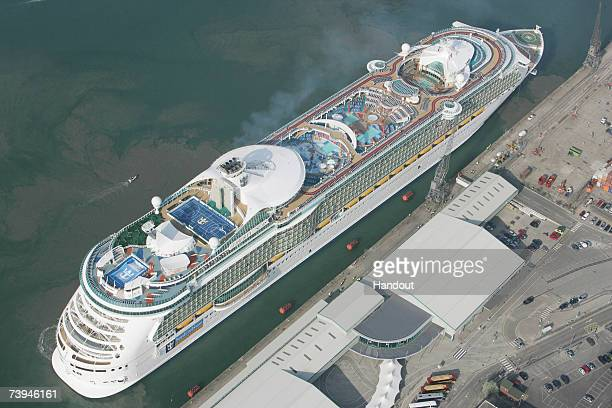 In this handout image an aerial view of the world's largest ocean liner the 'Liberty of the Seas' shows it arriving at the Port of Southampton on...