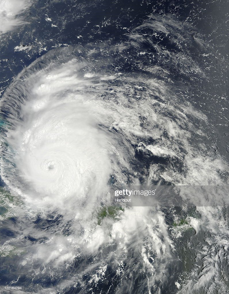 In this handout image captured by the Moderate Resolution Imaging Spectroradiometer (MODIS) aboard the Terra satellite and provided by NASA, a dense center can be seen surrounded by bands of thunderstorms which spiral tightly against the cloud-filled eye of Hurricane Irene August 25, 2011 as it moves across the Bahamas. At the time Irene was slowly moving across the Bahamas with sustained winds of 115 miles per hour (185 km/h), and classified as a Category 3 hurricane.