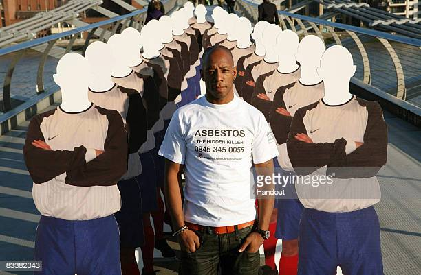 In this Handout image exfootballer Ian Wright poses on Millenium Bridge to launch the Health and Safety Executive's 'Asbestos The Hidden Killer'...
