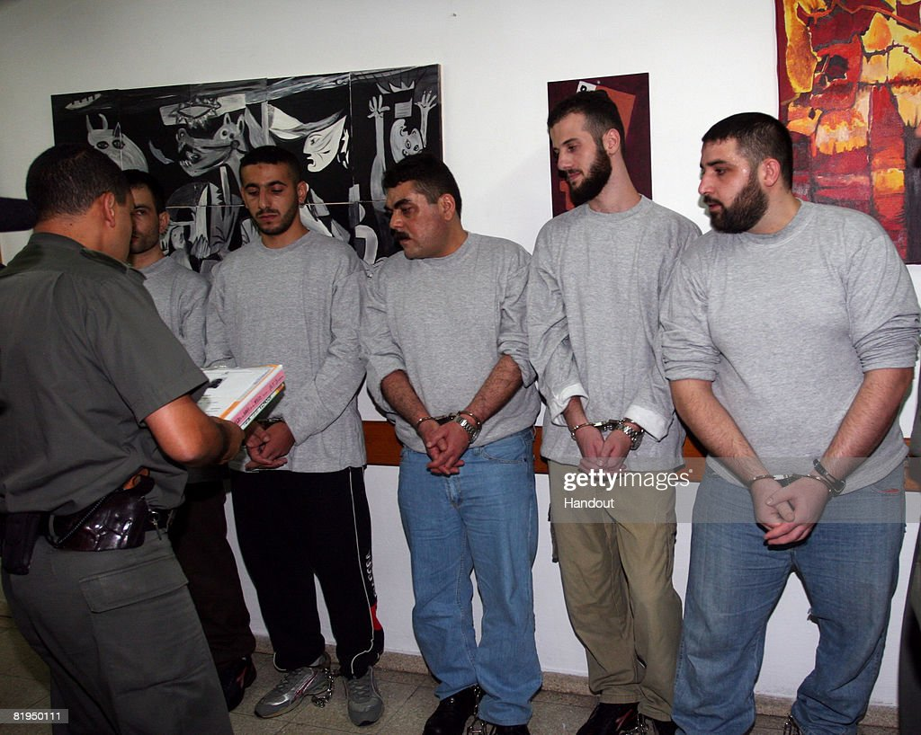 In this handout image from Hadarim Prison, Lebanese prisoners, including <a gi-track='captionPersonalityLinkClicked' href=/galleries/search?phrase=Samir+Kuntar&family=editorial&specificpeople=5440402 ng-click='$event.stopPropagation()'>Samir Kuntar</a> (3rd L), are processed for release on July 16, 2008 at the Hadarim Prison in central Israel. Kuntar, who was jailed in Israel in 1979 at the age of 16 for murder and attempted murder, was swapped in the UN mediated handover with soldiers Eldad Regev, 27, and Ehud Goldwasser, 32.