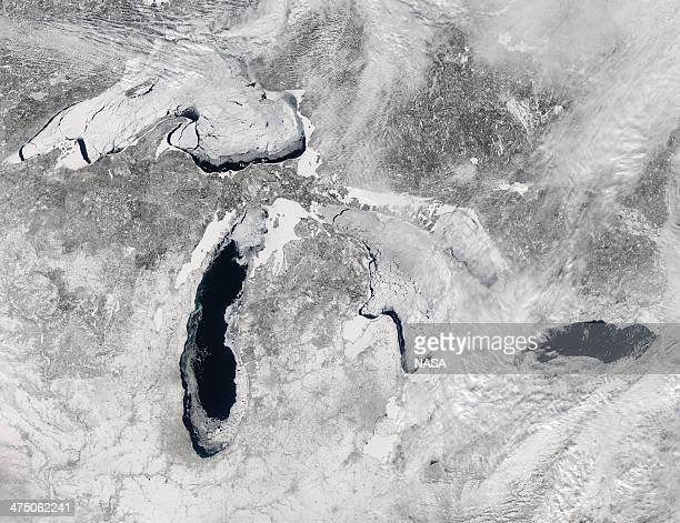 In this handout image from NASA the Great Lakes are seen with ice covering 803 percent of the lakes February 19 2014 from space According to National...