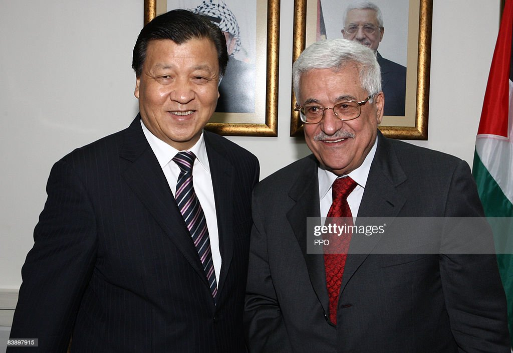 In this handout image from the Palestinian Press Office, Minister of Information of the Communist Party of China Mr. Liu Yunshan, (L) meets with Palestinian President Mahmoud Abbas on December 3, 2008 in Ramallah, West Bank.
