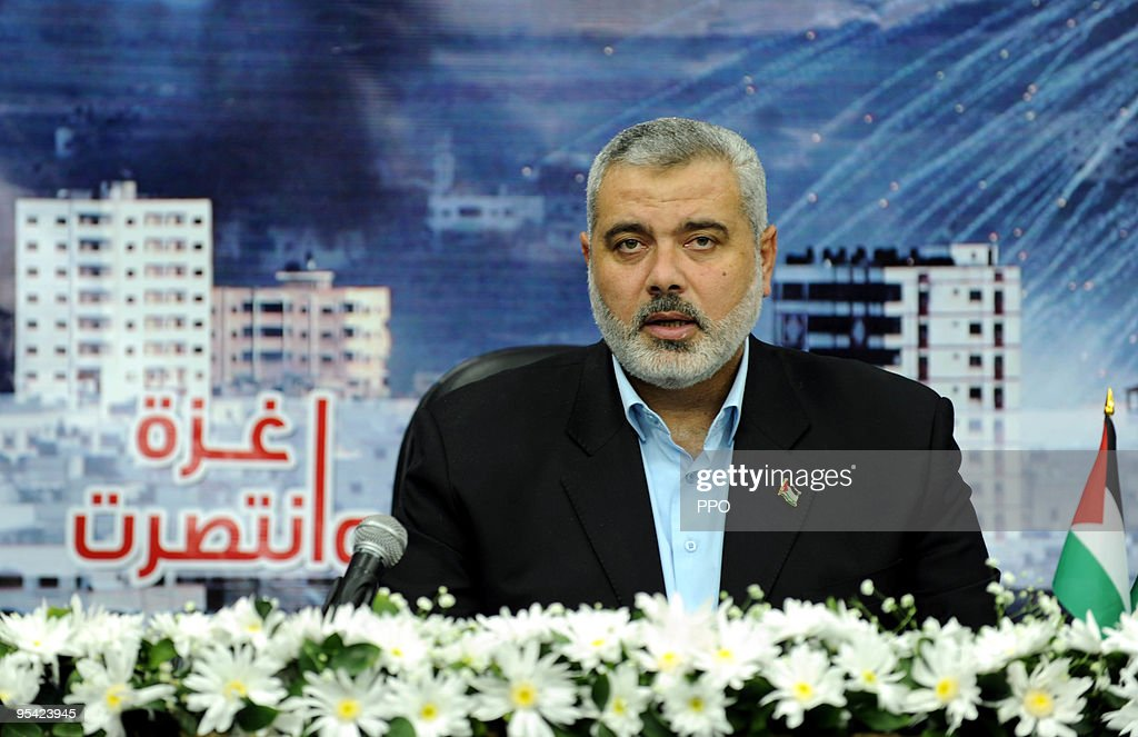 In this handout image from the Palestinian Prime Minister's Office (PPMO), Hamas chief in Gaza <a gi-track='captionPersonalityLinkClicked' href=/galleries/search?phrase=Ismail+Haniyeh&family=editorial&specificpeople=543410 ng-click='$event.stopPropagation()'>Ismail Haniyeh</a> speaks during a televised address from an undisclosed location on December 27, 2009 in the Gaza Strip. Haniyeh spoke of Gaza's 'steadfastness', on the first anniversary of the major Israeli offensive against the territory.