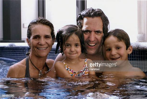 In this handout image from the Spanish Royal House Spanish Princess Elena and her husband Jaime de Marichalar pose with their children Victoria...
