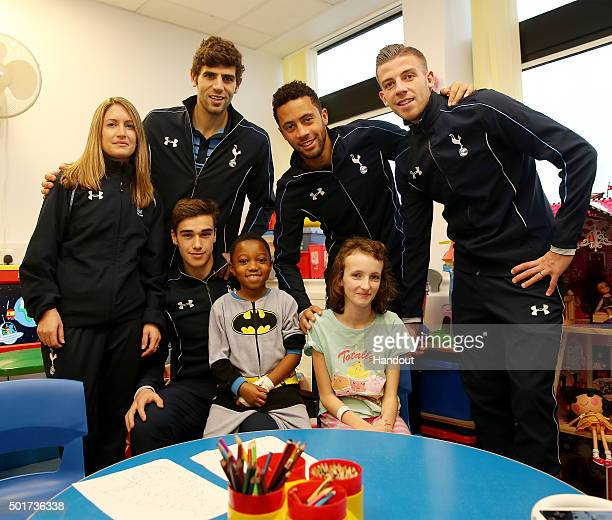 In this handout image from Tottenham Hotspur Jenna Schillaci Federico Fazio Mousa Dembele Toby Alderweireld and Harry Winks hand out presents to...