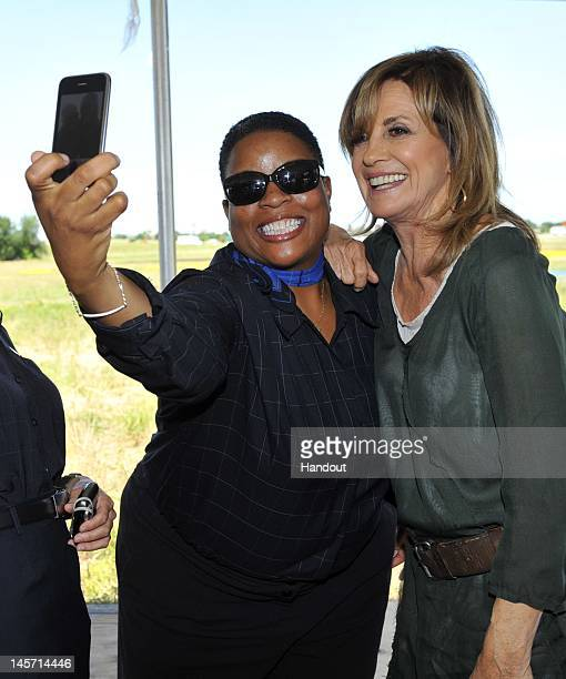 In this handout image Linda Gray is seen as TNT's Dallas cast celebrates JetBlue's new service into DFW with a 5 acre living billboard just outside...